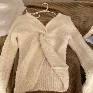 Super comfy and soft knit sweater, with open back!